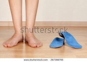 stock-photo-the-girl-s-legs-and-orthotics-267398795
